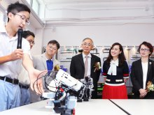 Mr. TSANG Fat-kuen, Manager of the IMC (L3), Mr. Terence CHAN, Secretary General of The Academy of Sciences of Hong Kong (R3), Principal Dr. POON Suk-han, Halina, MH (R2) and Ms. SO Wing-keun, Parent Manager of the IMC listening to the introduction of the robot design by students