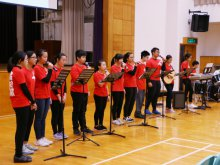 Christian Worship Group leading teachers and students to sing hymns